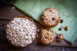 Oatmeal cookies with raisins on wooden background,vintage